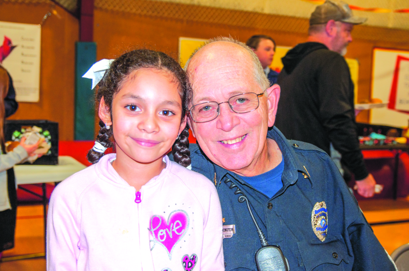 Laila Lopez with her grandfather-for-the-day Randy Pennington at the Winlock Grandparents Day lunch.