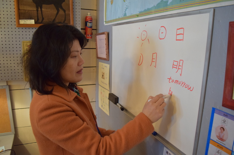 Photo by Todd Bennington - Language instructor Jane Powell demonstrates a few basic Chinese characters.