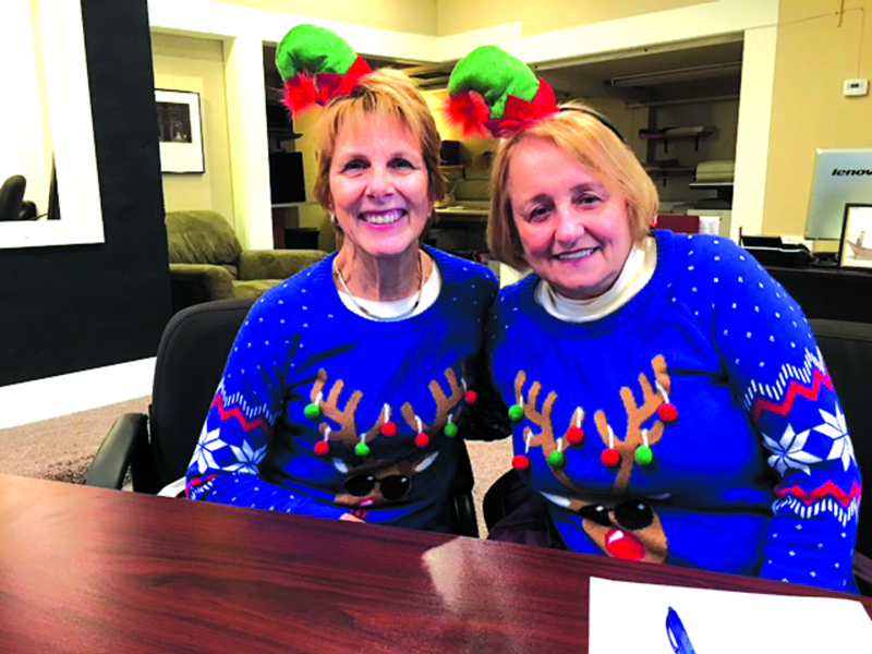Event co-chairs Bette Worth, left, and Bobbi McCracken display their matching reindeer sweaters last week in the offices of the Aberdeen Revitalization Movement. An online ugly sweater contest is among the features of Aberdeen's first annual Winterfest.