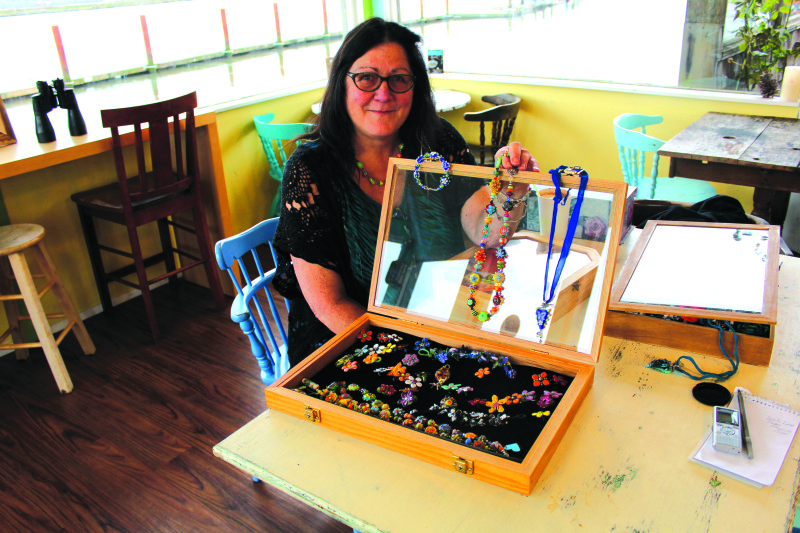 Local lampworker produces intricate bead designs