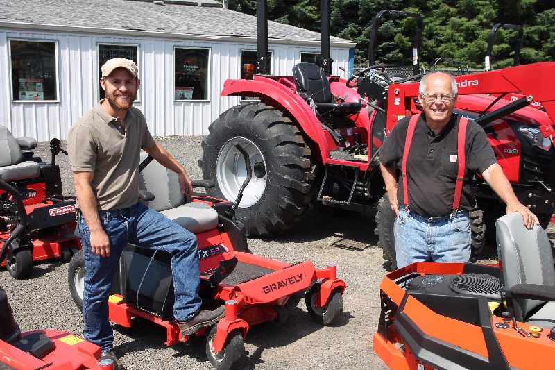 Richard Woolley (right) with son Justin outside of their business, Farm House Equipment, in Chehalis.