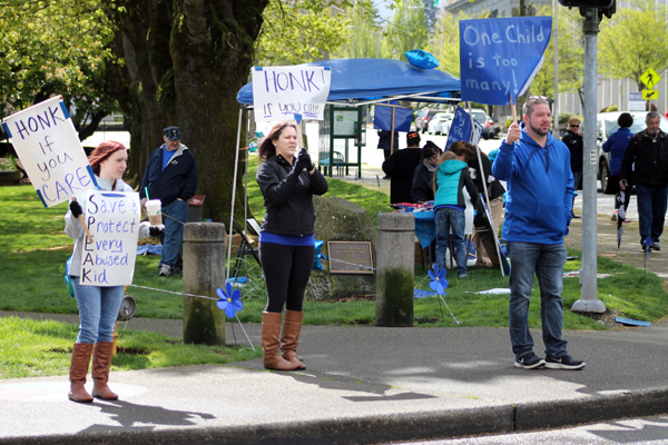 Locals march against child abuse in Olympia