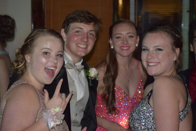 Photo by Todd Bennington - Local teens take a break from the festivities to smile for the camera during the joint prom event for the Raymond, South Bend, and Willapa Valley school districts held at the community center in South Bend on Saturday.