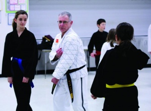 History teacher wears a black belt