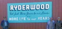 Volunteers restore Ryderwood's old 'Welcome' sign