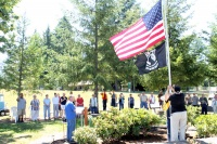 Ryderwood dedicates new flagpole, retires old emblems