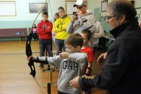 Local kids enjoy archery lesson from Lt. Governor Owen