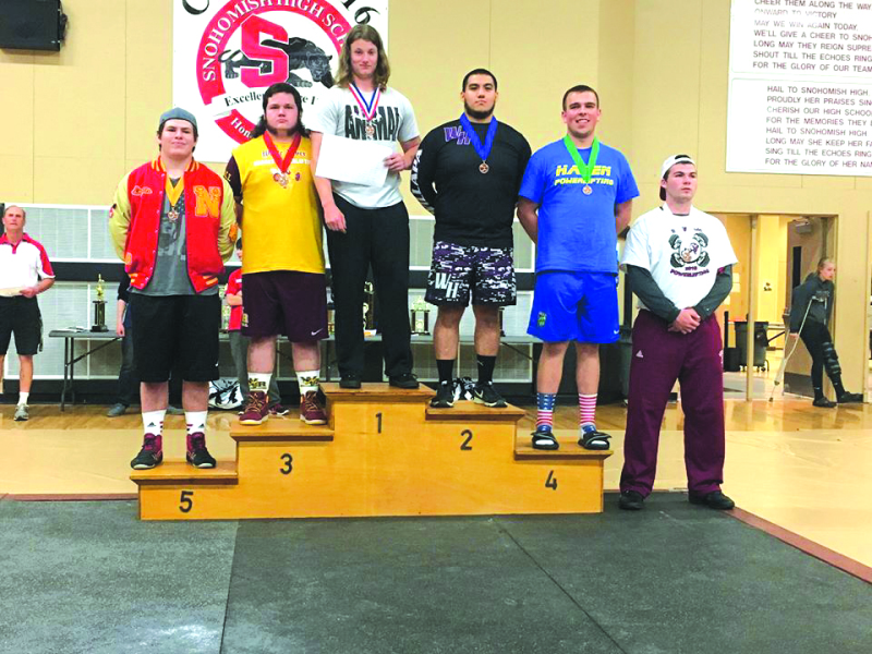 The power lifting champions of the state display their placements.