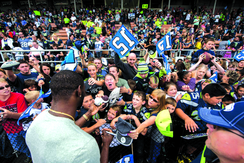 The Seahawks 12 Tour landed in Centralia on Saturday. Here, Ricardo Lockette is signing autographs for very anxious fans!