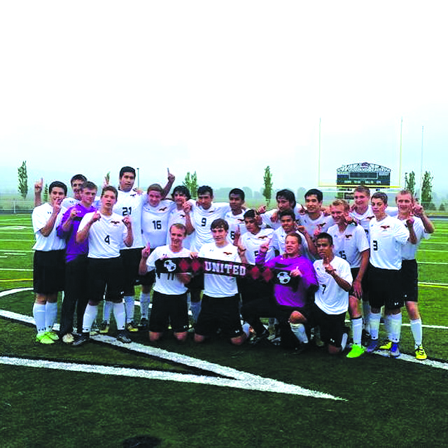 Photo taken by Lucas Patching - United poses for a picture after winning the District Championship.