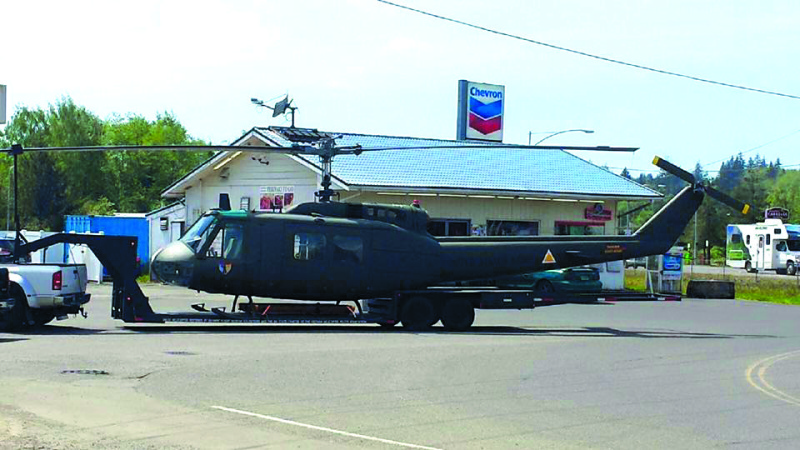 The Raymond Police Department snapped a photo of a UH1 Vietnam Era helicopter on it's way through town at the 101 Quickstop.