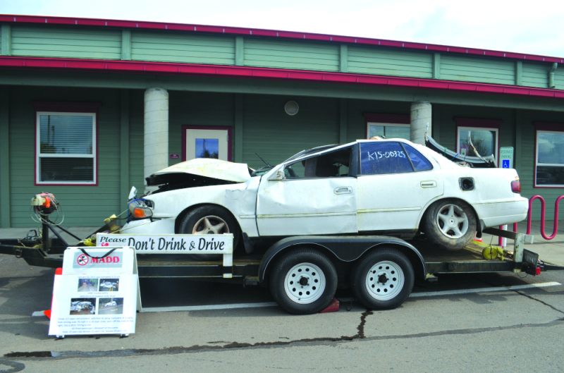 Photo courtesy of The Washington State Patrol - The WSP brought a car involved in a drunk driving crash which killed three people. This car was placed in front of the Winlock High School entrance to make students aware of drunk driving and its consequence