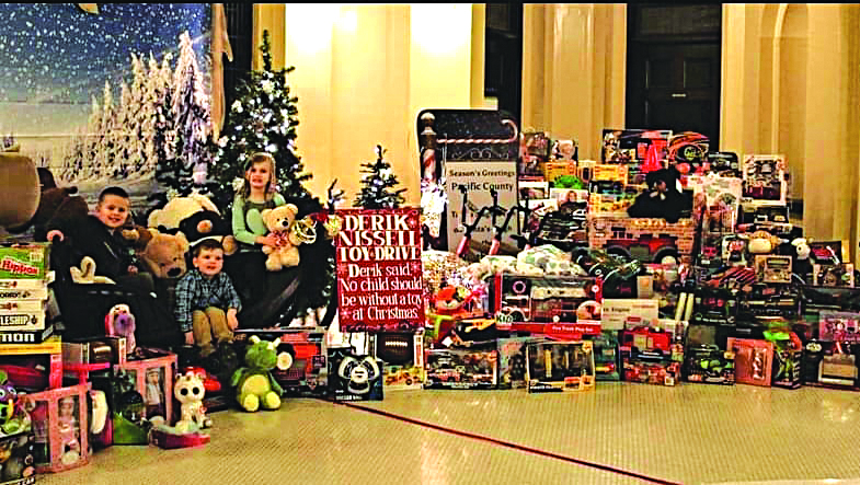Derik Nissell Toy House collecting and giving toys