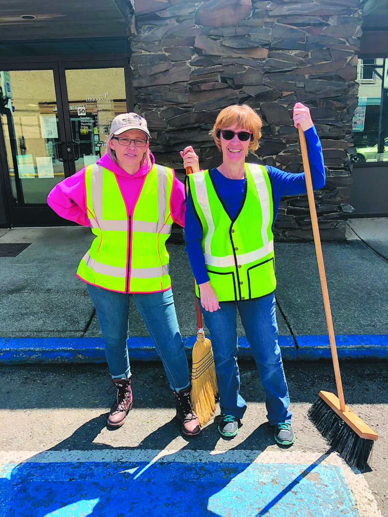 Cris Dodd and Stormy Bradley, Winlock City Office Staff is getting the streets ready Egg Day.