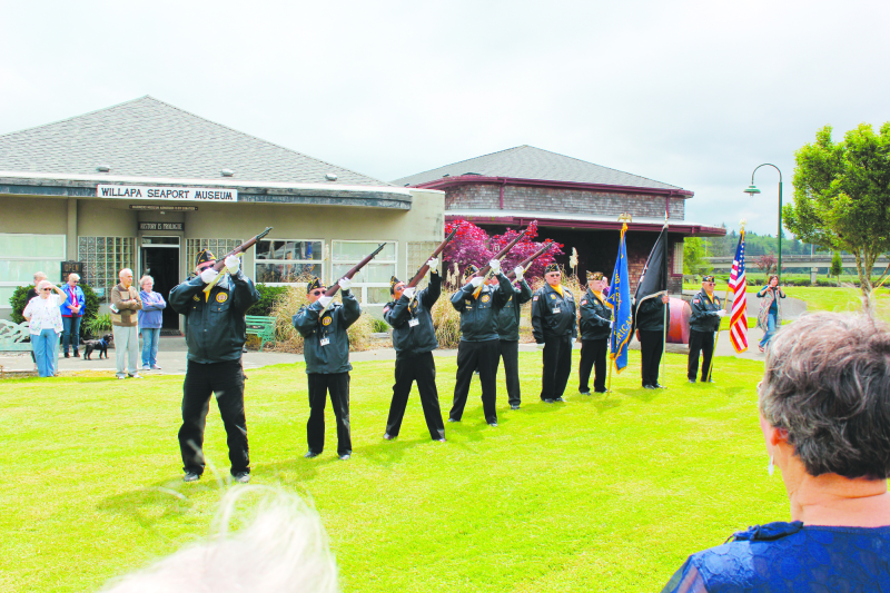 Photo by Jeff Clemens - The Raymond American Legion Post 650 providing a rifle solute to honor the fallen.