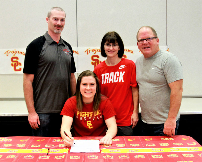 Photo by Larry Bale - Raymond track and field star Karlee Freeman signed a National Letter of Intent to attend USC next fall. In back from left are RHS Head Track and Field Coach/Athletic Director Mike Tully, and Karlee's parents, Briana Freeman and Phil