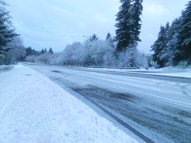 Photo by Jeff Clemens - US 101 was covered with several inches of snow overnight on Friday, February 8 which left icy and slippery conditions Saturday, February 9. Pictured is US 101/North River Rd. near milepost 75. DOT worked hard through the night and