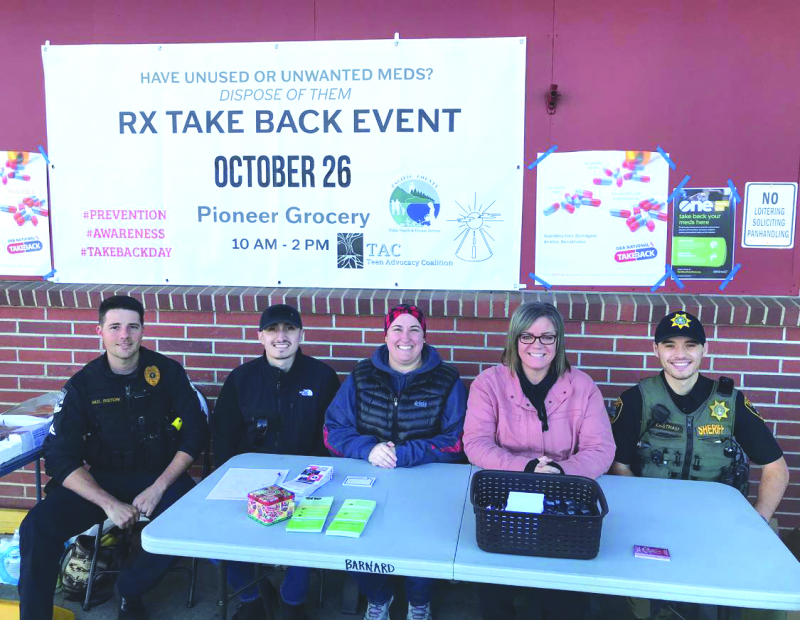 Representatives of local agencies helped with the Drug Take Back on Saturday, October 26 in front of Pioneer Grocery in South Bend: left to right: Micah Ristow, Raymond Police Department; Luis Gonzalez, South Bend Police Department; Bethany Barnard, Pacif