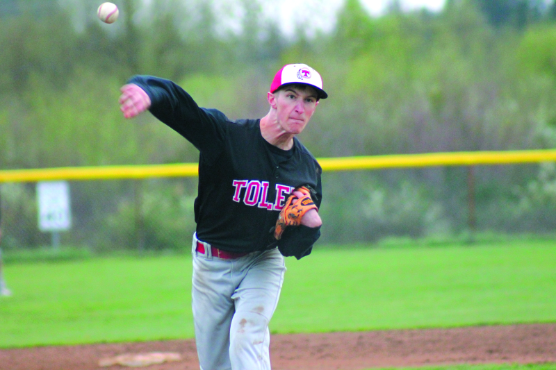 Photo by Nolan Patching - Toledo's pitching ace Wes Kuzminsky delivers a pitch in the fourth inning against Winlock. Kuzminsky allowed two runs on three hits and struck out seven, paving the way to an Indian win.