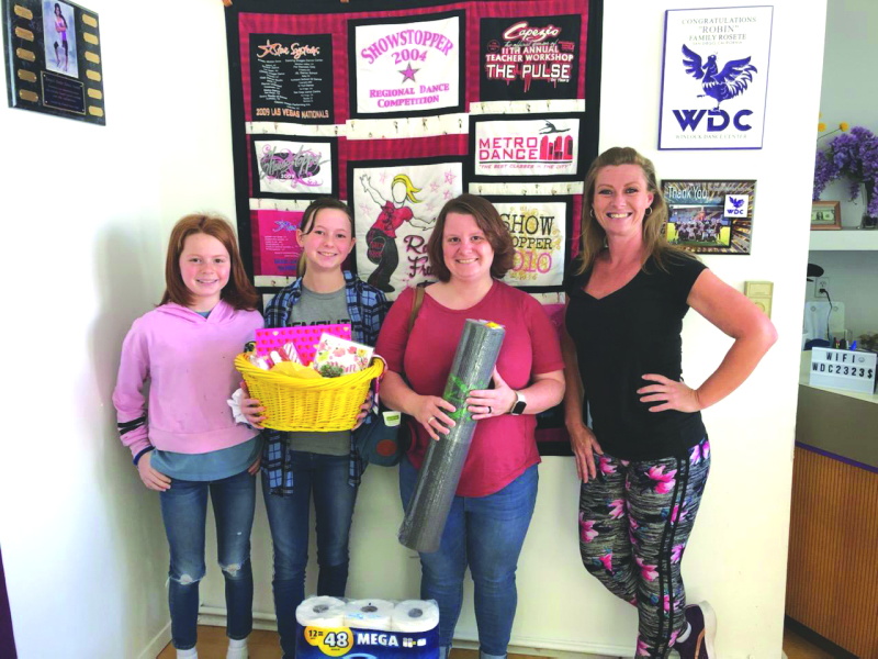 Left to right: Koko Austin (sister), Emily Austin (winner), Alycia Cramer (mom), and Robin Brumley