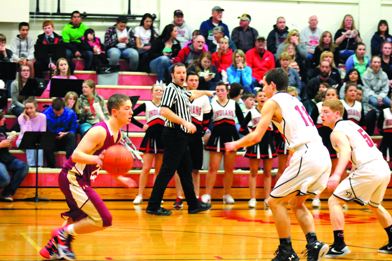 Photo by Kennedi Collins - Nick Patching of Winlock looks for an opening as he goes to dribble around his opponents.