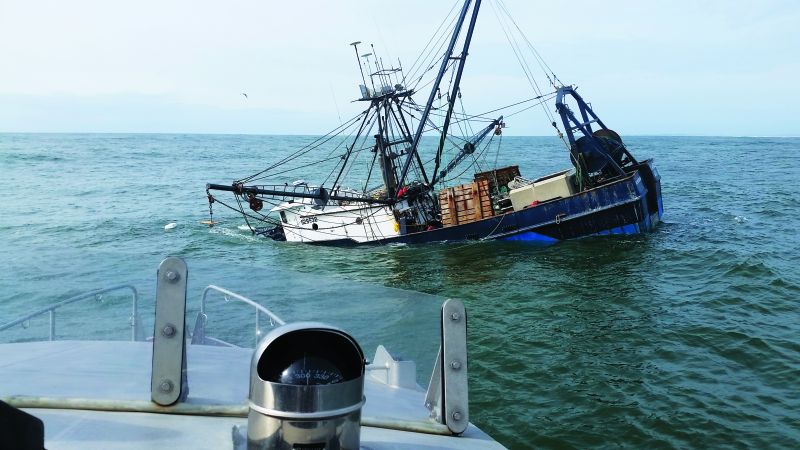Photo by U.S. Coast Guard Petty Officer 2nd Class Jacob Hylkema The 74-foot fishing vessel Privateer sinks approximately one mile north of Grays Harbor, Wash. April 15, 2016.  The Oil Spill Liability Trust Fund was opened to assess the salvage.