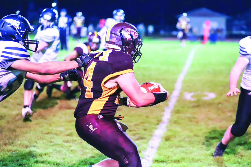 Photo by Larry Bale - South Bend HS senior Chase Flynn was a workhorse for the Indians in their 48-34 victory over Mary M. Knight, as he was in every game for the Tribe this past season. Here, he drags a tackler along for a few more yards.
