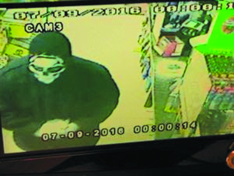 A surveillance camera photo of the man who robbed the Winlock Handi Store at gun point.