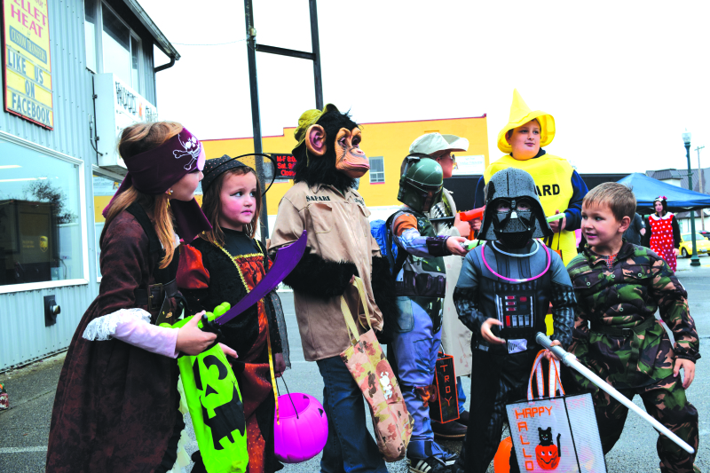Rainy weather does not discourage trick-or-treaters