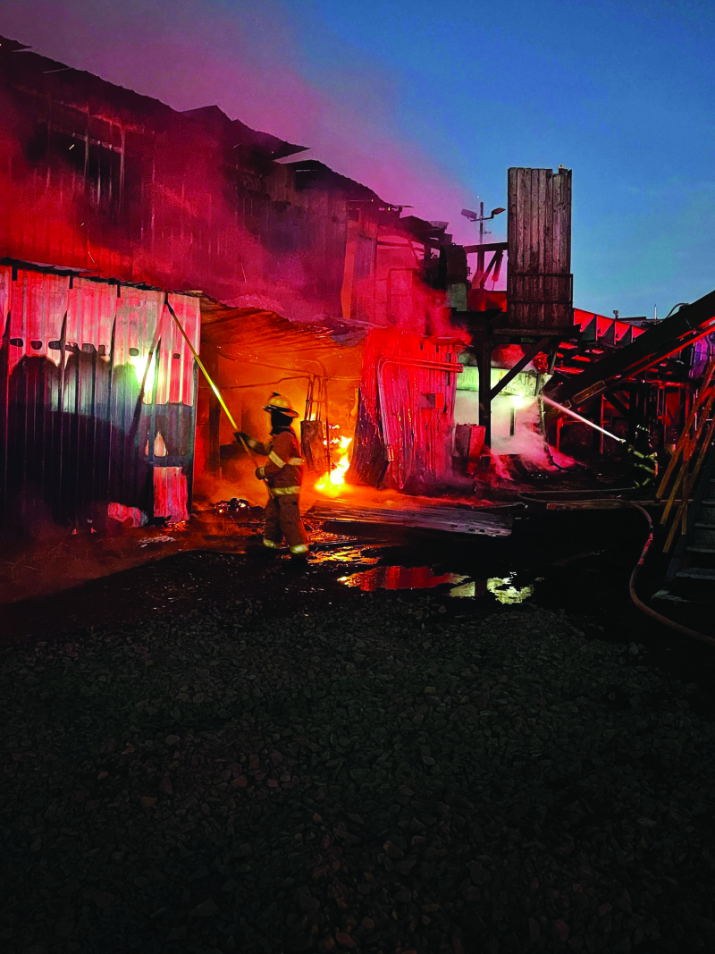 Photo by Shelly Rhodes - Firefighters worked throughout the early morning to extinguish the Winlock Fiber Lumber Mill.