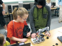 Toledo students showcase robotics skills for District Board