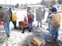 Winlock volunteers brave snow to help 'Clean Up the Coop'