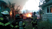 Local firefighters responded to a five-alarm blaze near Toledo